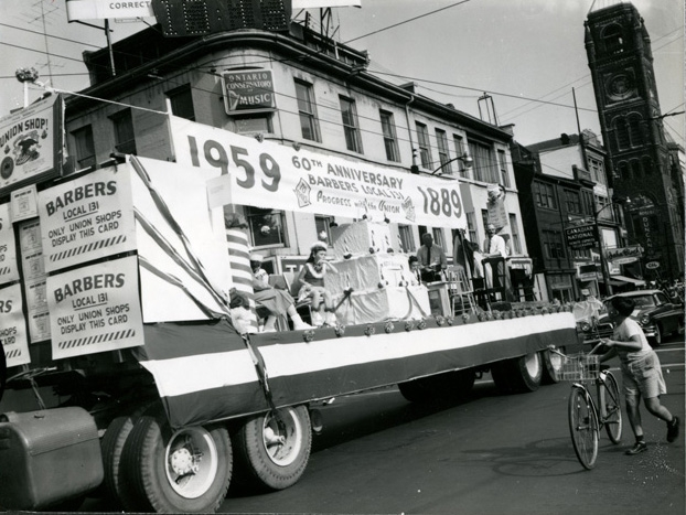 Here is a float celebrating the 60th anniversary of Barbers Local 131 moving up James Street North on September 8, 1959. They have just reached the corner of King and James and you can see the old City Hall in the background.