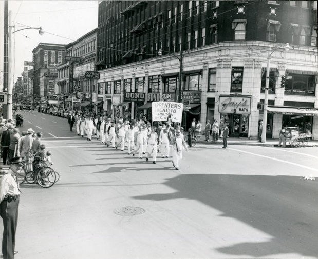 Carpenters Union Local 18 marching up James Street on September 2, 1958. They are just passing the Lister Building at the corner of King William Street.