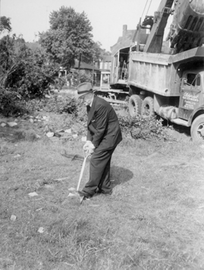 Mayor Jackson digs the first shovelful of dirt for the construction of City Hall, 1958