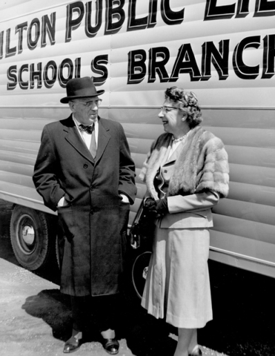 Photo of Mayor Lloyd D. Jackson and Freda Waldon, Chief Librarian in front of a Bookmobile in 1961, Hamilton Spectator